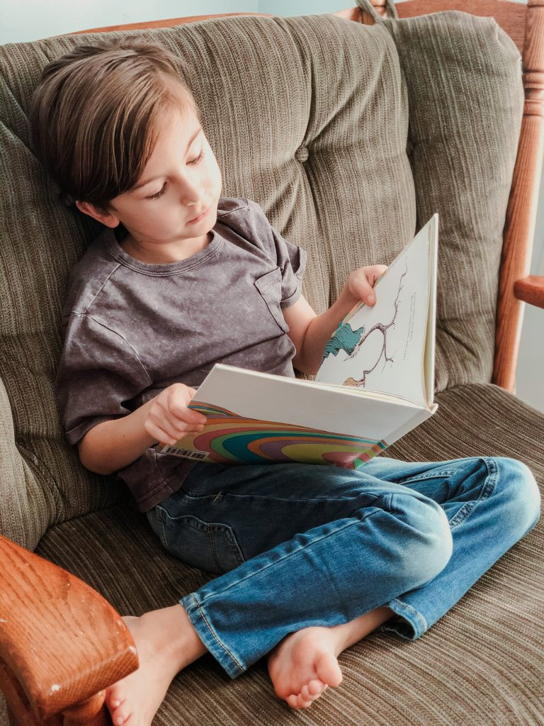picture of boy reading Dr. Seuss Oh The Places You'll Go